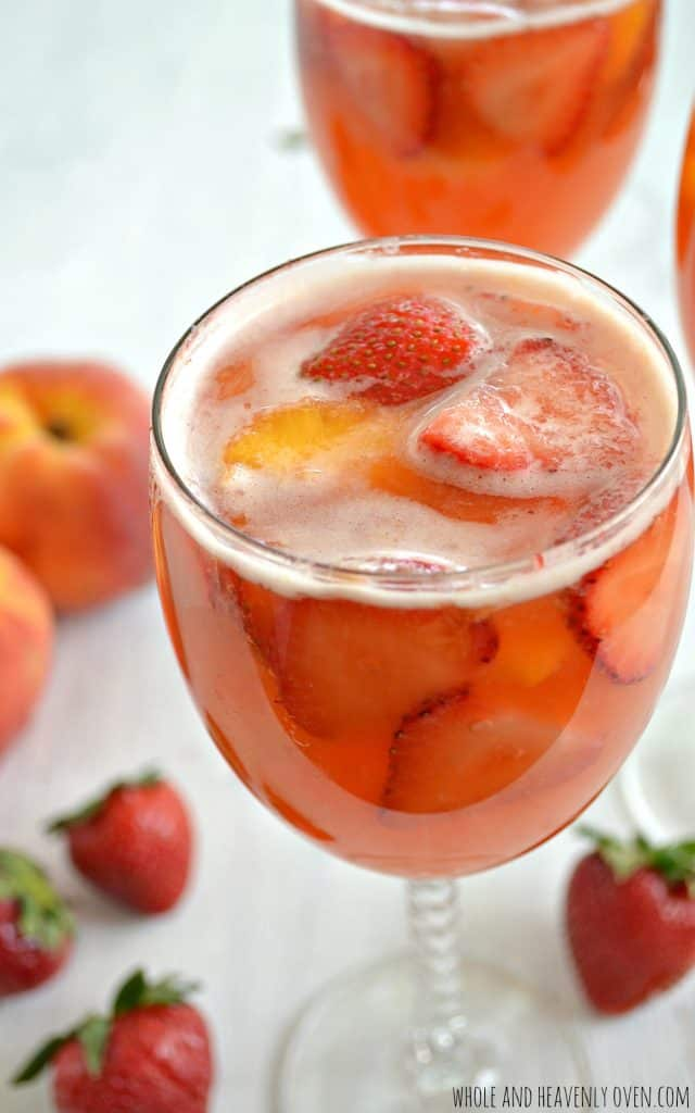 Sparkling Strawberry Peach Sangria   wholeandheavenlyoven.com