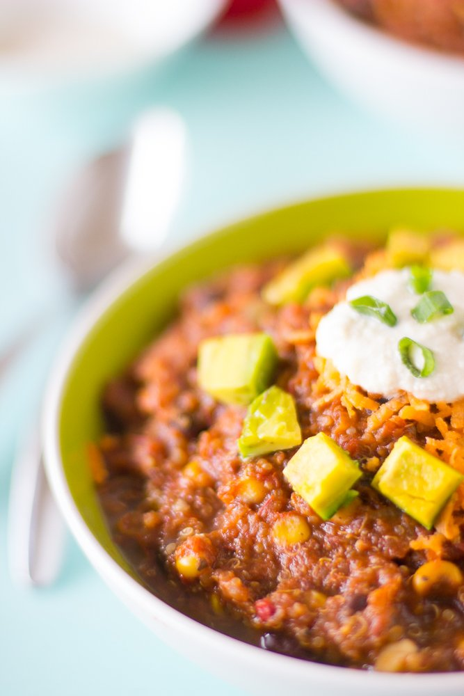 This Vegan Crockpot Quinoa and Black Bean Chili needs only 10 minutes prep then right into the crockpot! It results in a thick, filling and delicious chili. #vegan #chili #healthy #blackbean #quinoa #crockpot #slowcooker