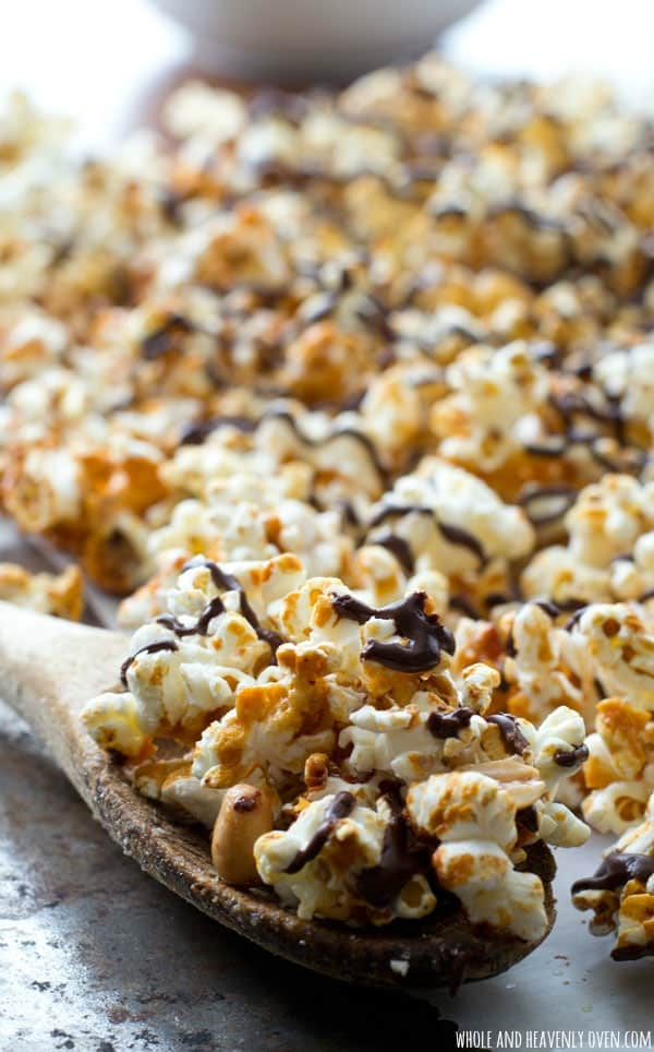 Covered in chocolate and caramel and loaded with crunchy peanuts, this addicting caramel popcorn is definitely the ultimate holiday snack! @WholeHeavenly