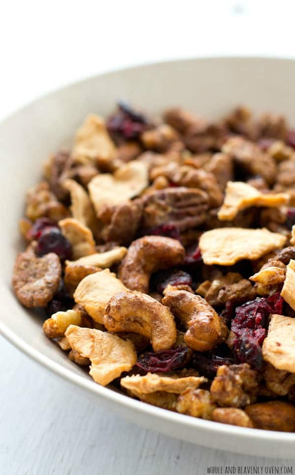 Sugary candied nuts and plenty of dried cranberries and apples come together in this addicting snack mix.---You can't help but go back for another handful! @WholeHeavenly