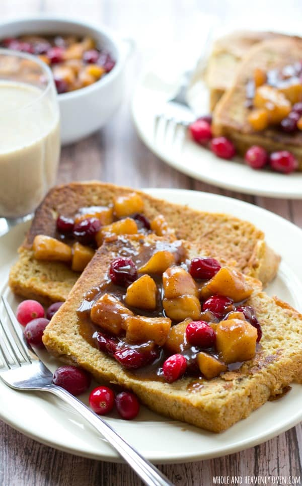 This cozy french toast is the best way to use up that leftover eggnog! A warm cranberry-apple syrup pairs perfectly atop a tall stack for a heartwarming winter breakfast! @WholeHeavenly