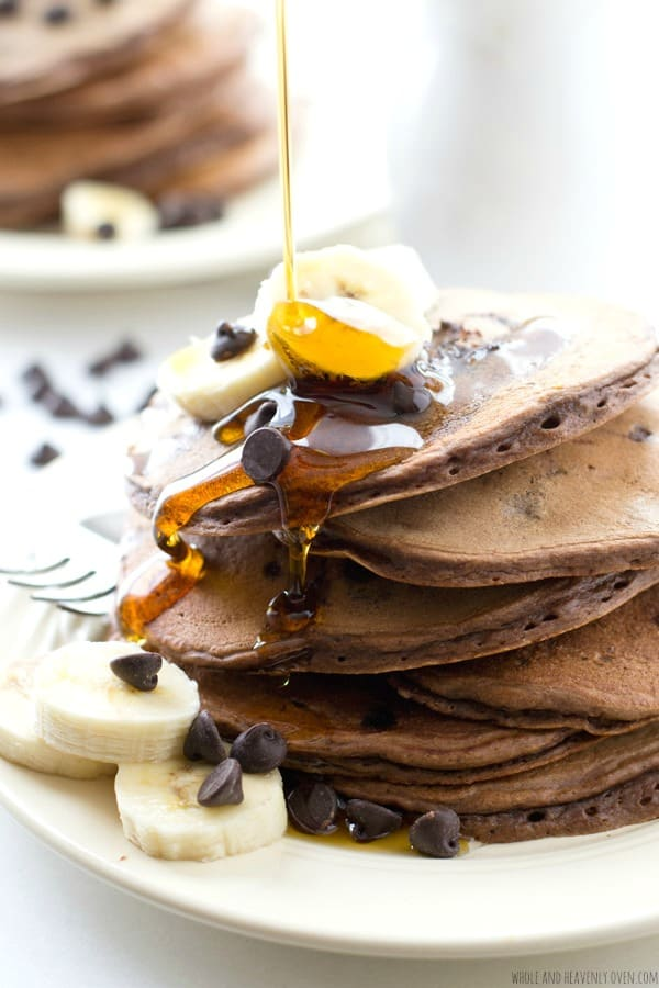 "These thick, fluffy pancakes are loaded with lots of banana flavor and a double-delight of chocolate---Your family will go ""bananas"" for these crowd-pleasing pancakes! @WholeHeavenly"