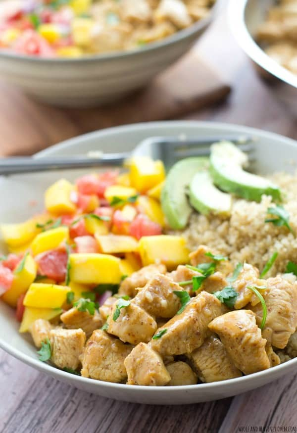 These easy quinoa bowls are loaded with SO much flavor and you won't believe how quickly they come together! The honey mustard chicken pairs perfectly with fluffy quinoa and a sweet tropical salsa. @WholeHeavenly