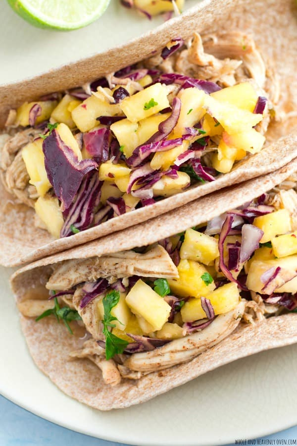 All the best Caribbean flavors collide with cozy comfort food in these slow-cooked chicken tacos that are loaded with tender sweet 'n 'spicy chicken and lots of fresh pineapple slaw.