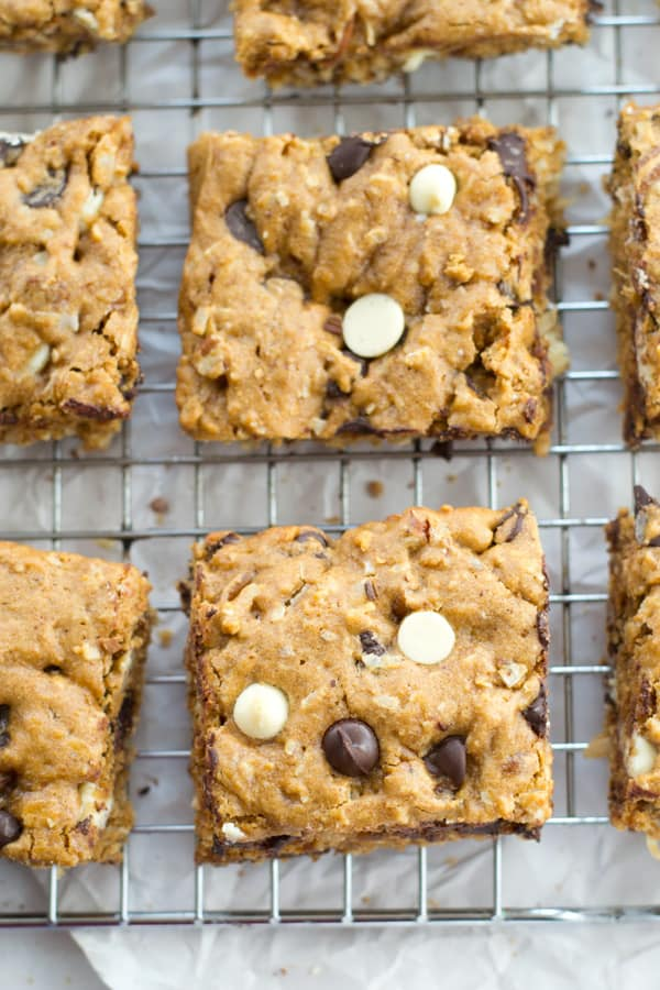 Loaded with two kinds of chocolate and lots of nuts and coconut, these ultra-chewy classic blondies truly are the ultimate! You won't believe how easy they are to make. @WholeHeavenly