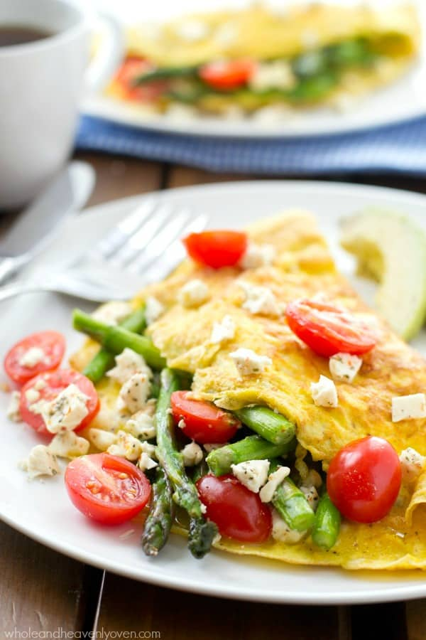 Loaded with tender asparagus, juicy cherry tomatoes and lots of soft feta cheese, these springtime omelets whip up in minutes and are perfect for a healthier brunch!