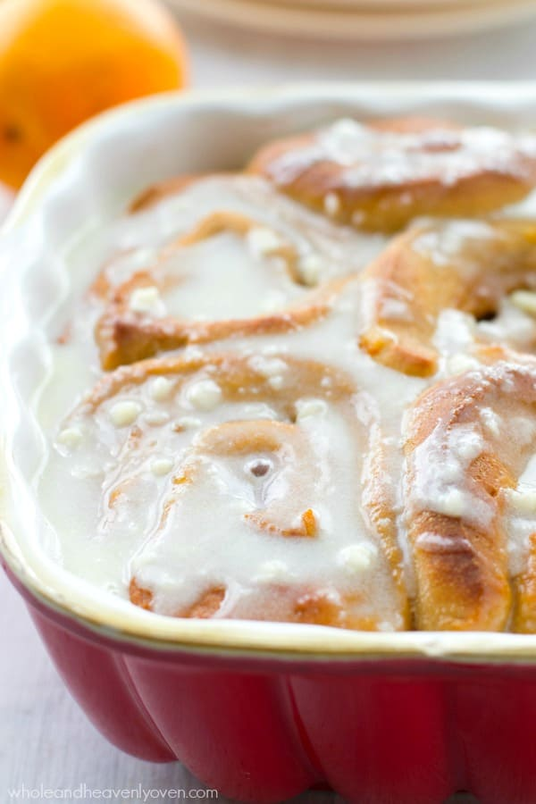 Swirled with a citrus-y orange marmalade-cinnamon sugar filling and drizzled with tons of cream cheese icing, these bright, cheerful cinnamon rolls are ideal for any spring brunch! @WholeHeavenly