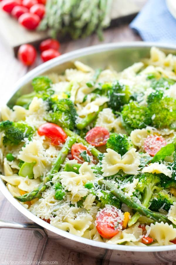 Loaded with a rainbow of springtime vegetables and lots of Parmesan, this garden-fresh pasta primavera is a delicious and healthy spring side dish!