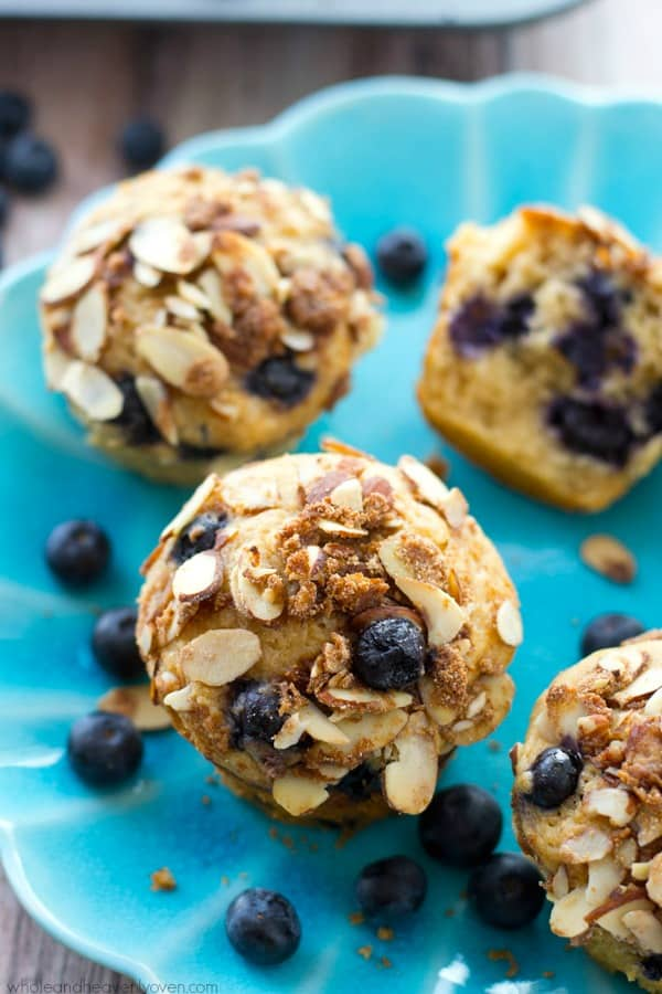 These big bakery-style blueberry muffins will be the star of your brunch! Supremely moist inside, loaded with juicy blueberries and topped with a buttery almond crumble topping. @WholeHeavenly