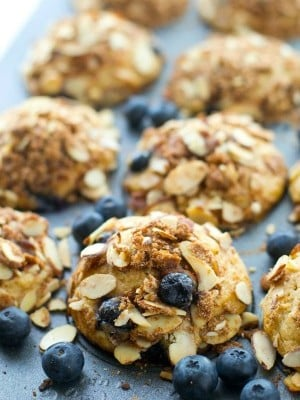 These big bakery-style blueberry muffins will be the star of your brunch! Supremely moist inside, loaded with juicy blueberries and topped with a buttery almond crumble topping.