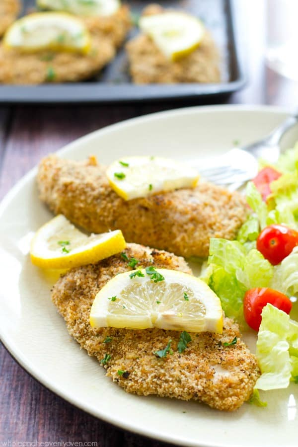 30 minutes and one pan is all you'll need to make these simple oven-baked chicken tenders that are coated in a garlicky-lemon breading and unbelievably crispy! @WholeHeavenly