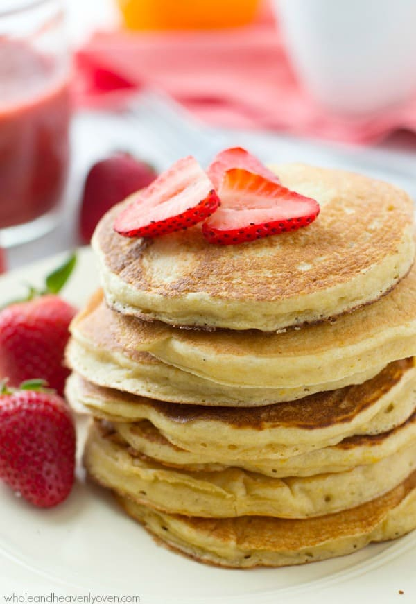 These orange-flavored pancakes are unbelievably moist and fluffy thanks to the greek yogurt and are heavenly topped with a sweet roasted strawberry sauce! @WholeHeavenly