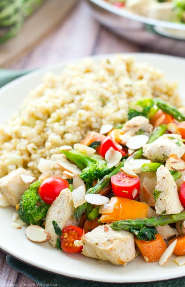 Chicken asparagus stir fry with tomatoes toasted almonds dinners on in only 30 minutes with this veggie loaded chicken stir fry forumfinder Images