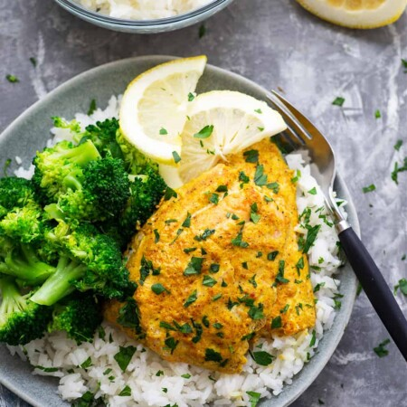 Traditional grilled tandoori salmon is marinated in a spiced yogurt marinade, grilled until tender, and piled on top of fluffy lemon basmati rice.--it'll quickly become a dinner regular!