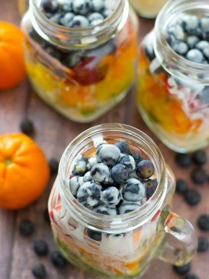 Take your fruit salad along to those summer picnics the easy way......layered rainbow-style in a pretty jar with a tangy citrus yogurt dressing!