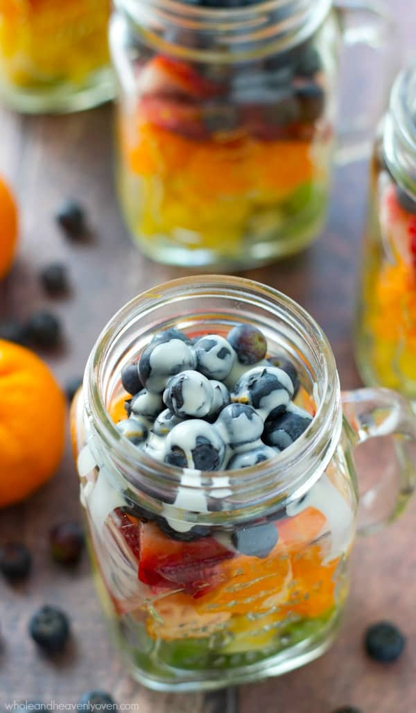 Take your fruit salad along to those summer picnics the easy way......layered rainbow-style in a pretty jar with a tangy citrus yogurt dressing! @WholeHeavenly