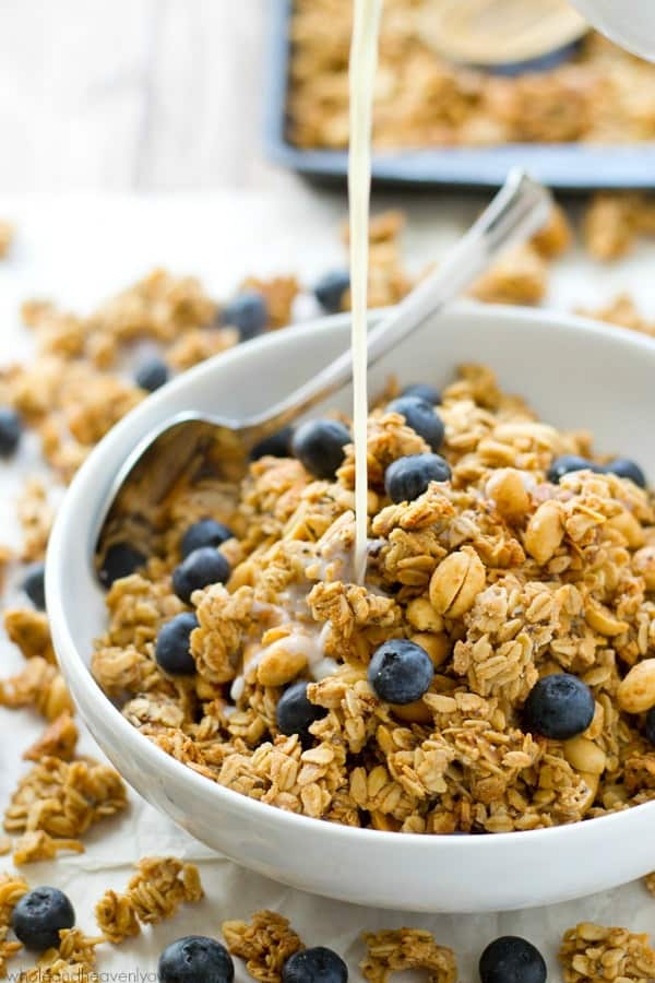 You won't believe that this loaded peanut butter granola is good for you! It's so crunchy, peanut butter-y and addicting, you'll want to eat it all straight from the pan! @WholeHeavenly