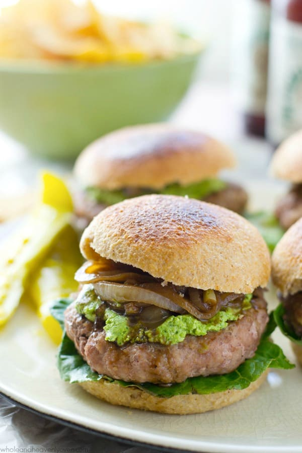 These ultimately-juicy turkey burgers will make any summer night a party! A silky spinach whipped feta and plenty of tangy caramelized onions take them over the top in the flavor department. @WholeHeavenly