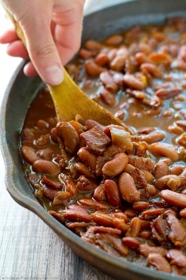 Sweet, tangy and just a little bit spicy, these baked beans are made completely from scratch and cook away for hours in the crockpot.---Their awesome flavor will knock your cookout guests socks off! @WholeHeavenly