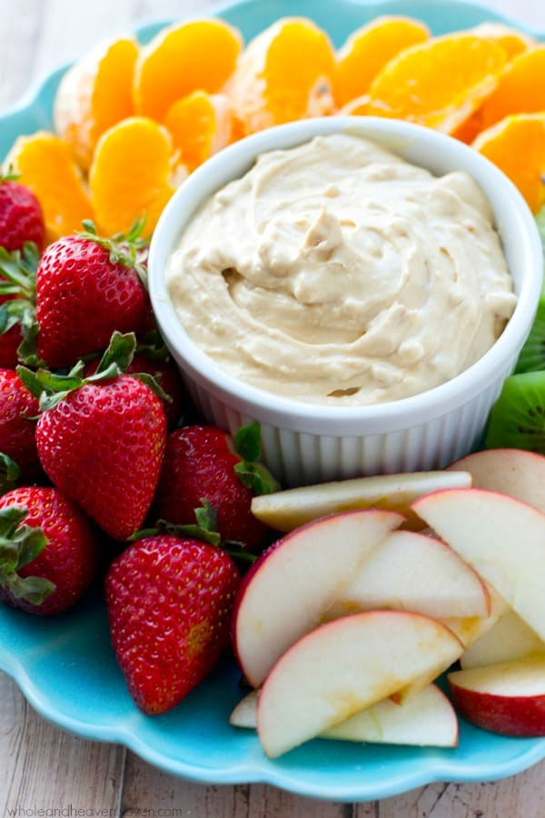 Smooth, creamy and unbelievably addicting, this simple peanut butter cheesecake dip will make any fruit fun to eat! @WholeHeavenly