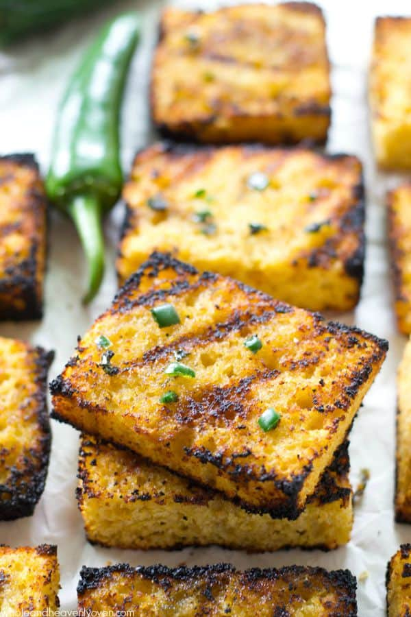Soft, irresistible homemade cornbread squares are slathered up with a kickin' jalapeno honey butter and then quickly cooked on the grill to crisp, buttery heaven! @WholeHeavenly
