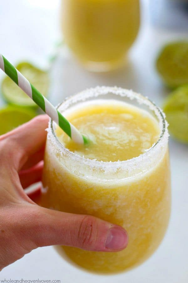 You'll feel like you took a trip to the tropics after one sip of these icy-cold, tropical-style margarita slushies! 5 minutes and a few basic ingredients is all you need!