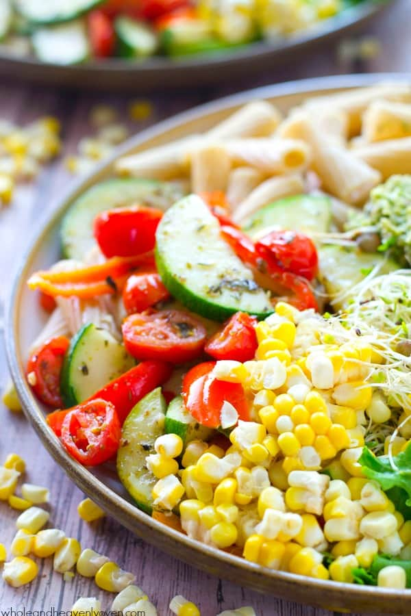 Loaded with just about every veggie on the planet and lots of grilled chicken, these super-fresh and healthy, California-style pasta bowls are an awesome way to use up all that summer produce!
