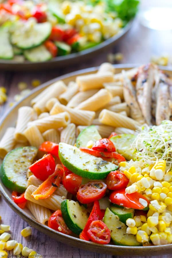 Loaded with just about every veggie on the planet and lots of grilled chicken, these super-fresh and healthy, California-style pasta bowls are an awesome way to use up all that summer produce! @WholeHeavenly