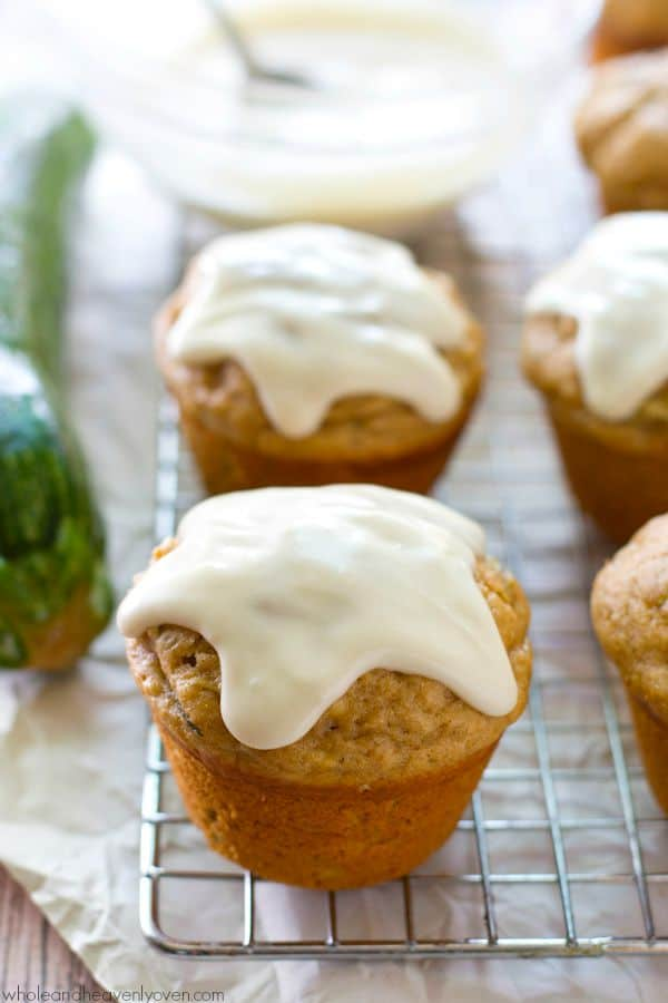 These super-soft zucchini muffins are exploding with banana flavor and covered every inch in an irresistible cream cheese glaze.---no one will ever guess they're healthy! @WholeHeavenly