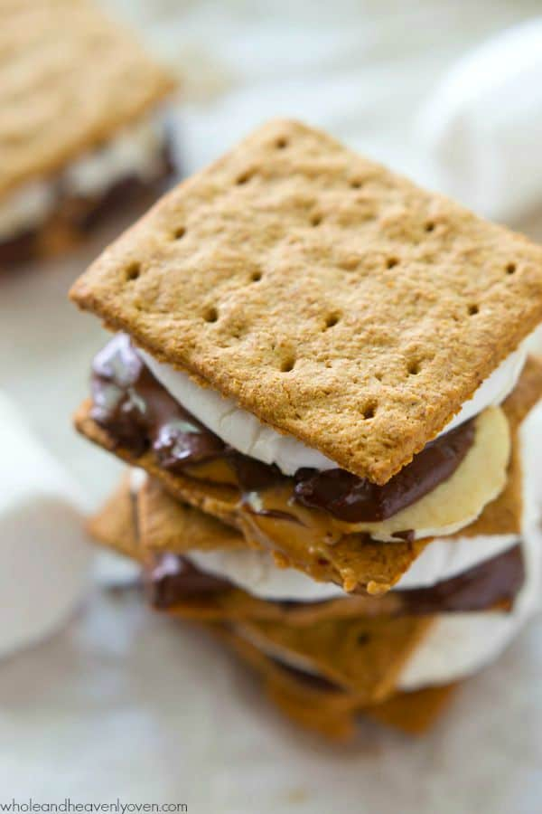 Layered with banana slices, creamy peanut butter, gooey chocolate and marshmallow, no one will be able to resist these ultimate s'mores! --- Includes directions for either oven or campfire method. @WholeHeavenly