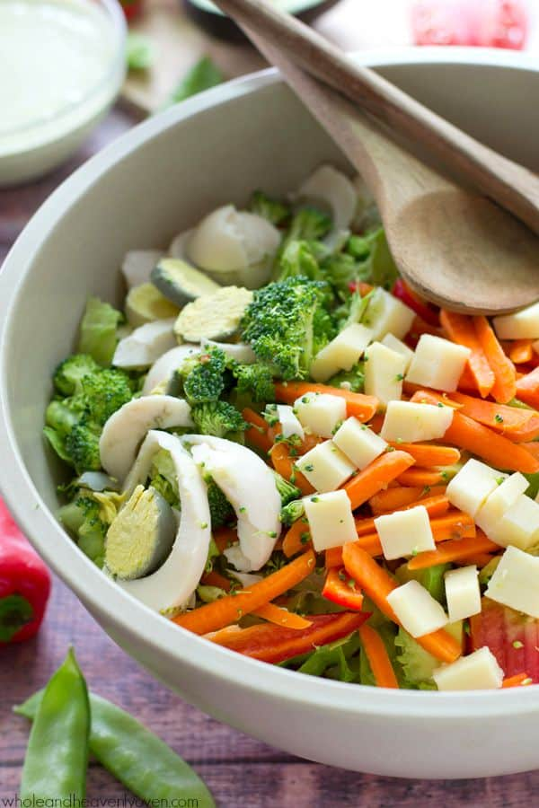 A rainbow of fresh summer veggies combines with the classic chef's salad and an extra-creamy pesto ranch dressing in this ultimate veggie-lover's lunch salad! @WholeHeavenly