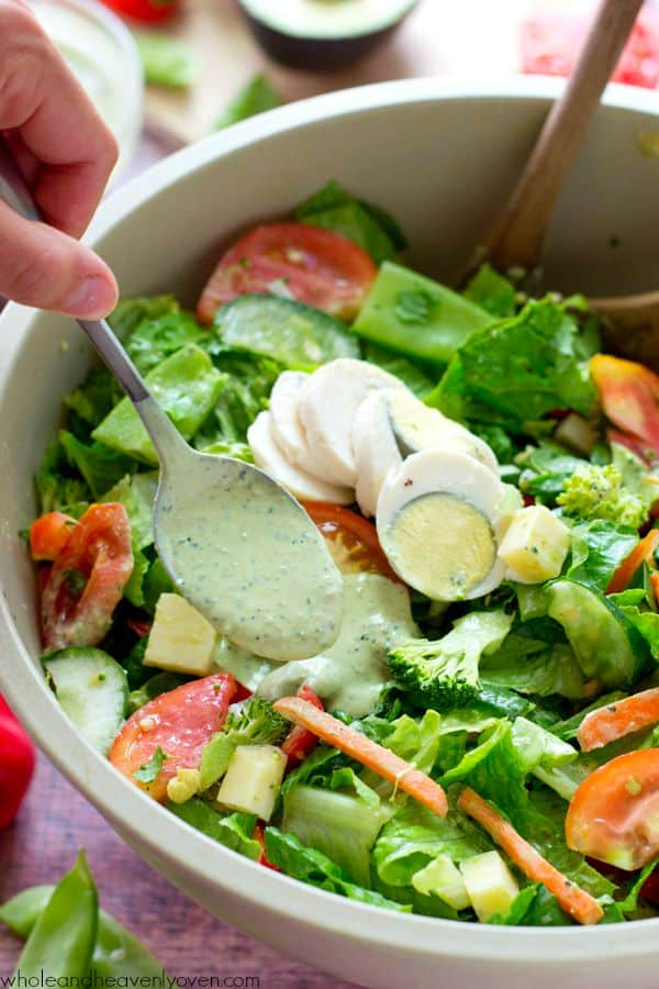 A rainbow of fresh summer veggies combines with the classic chef's salad and an extra-creamy pesto ranch dressing in this ultimate veggie-lover's lunch salad!