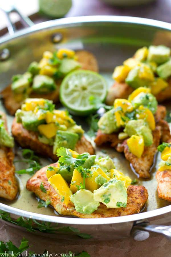 Extra-juicy, cajun-rubbed chicken tenders are piled high with a sweet 'n' spicy mango avocado salsa for one super-easy and flavorful weeknight chicken dinner! @WholeHeavenly