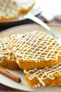 French toast is given a fun fall twist with this extra-moist pumpkin spiced french toast that's generously drizzled with a cream cheese glaze. @WholeHeavenly