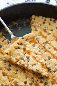 Skip the flour AND the hassle of rolling out cookie dough when you make this extra-chewy giant chocolate chip cookie with plenty of gooey caramel on top!
