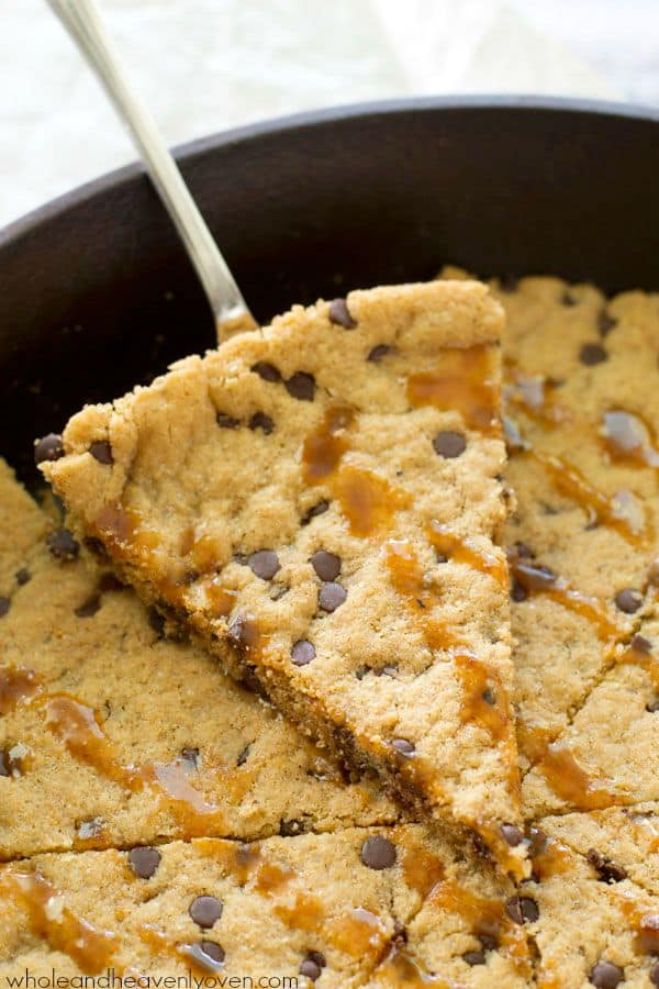 Skip the flour AND the hassle of rolling out cookie dough when you make this extra-chewy giant chocolate chip cookie with plenty of gooey caramel on top! @WholeHeavenly