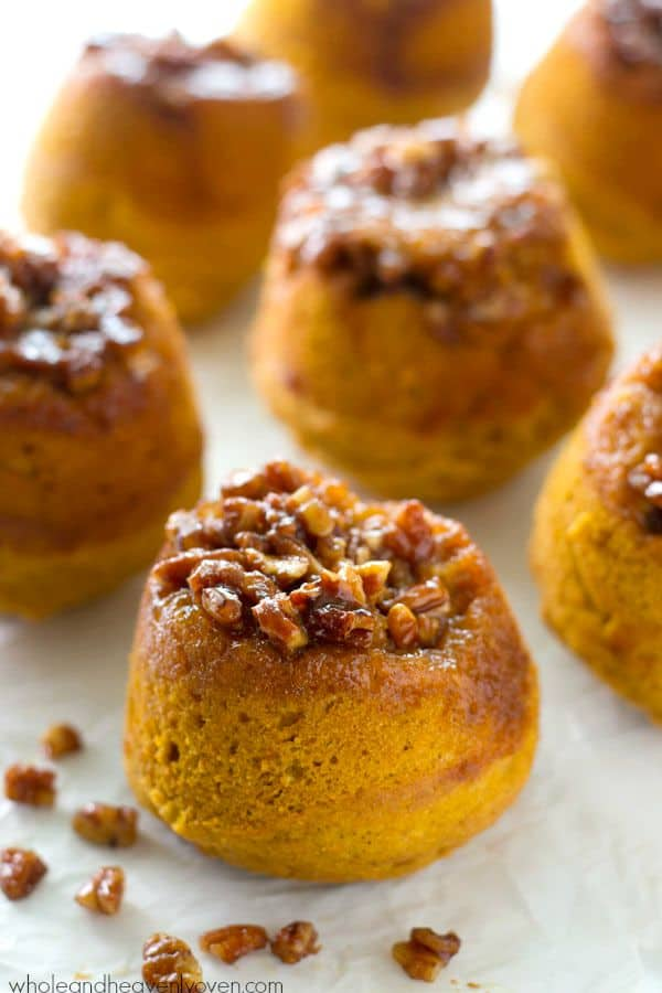 An irresistible sticky pecan topping stars in these soft pumpkin spiced muffins---like a cross between a sticky bun and a muffin all rolled in one! @WholeHeavenly