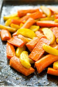 Roasted in maple syrup and tons of zingy Moroccan spices, these roasted carrots and apples are an easy yet elegant addition to any fall dinner!