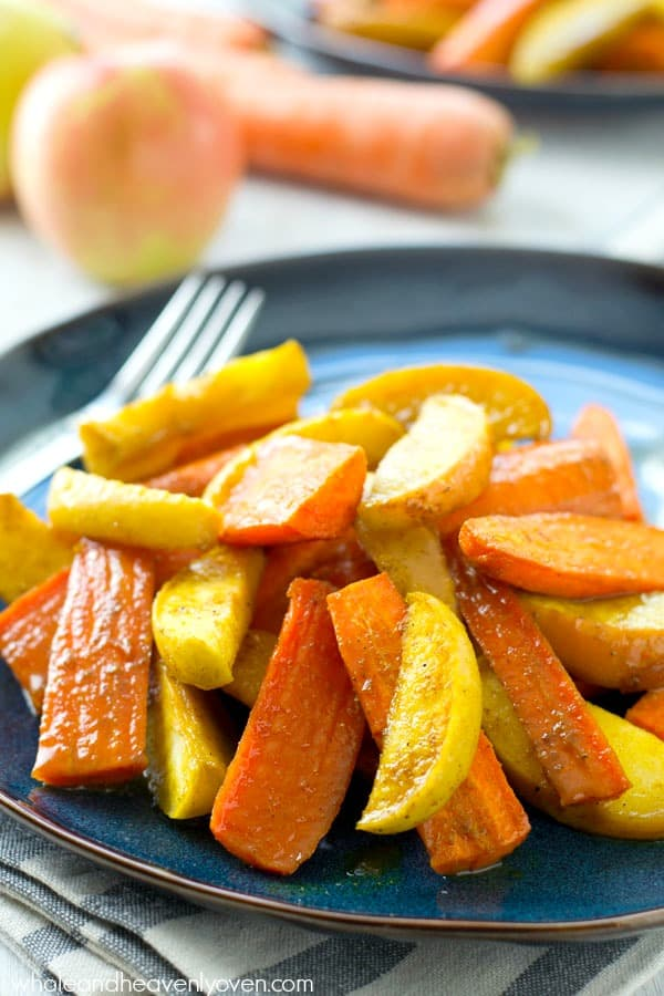Roasted in maple syrup and tons of zingy Moroccan spices, these roasted carrots and apples are an easy yet elegant addition to any fall dinner! @WholeHeavenly