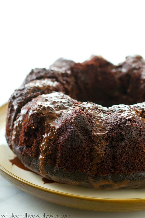 "Drizzled with chocolate ganache glaze and unbelievably fudgy and moist inside, this chocolate bundt cake definitely lives up to it's name of ""best-ever.""---It's a birthday cake favorite! @WholeHeavenly"
