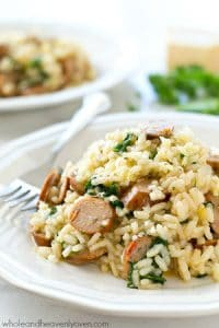 Creamy restaurant-style parmesan risotto loaded with plenty of sausage and kale, and made in one pot in only 30 minutes! Dinner is going to rock.