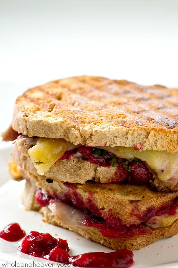 Use up those Thanksgiving leftovers the easy way with this ultimate leftover turkey cranberry mozzarella panini sandwich.---Lunch is served! @WholeHeavenly