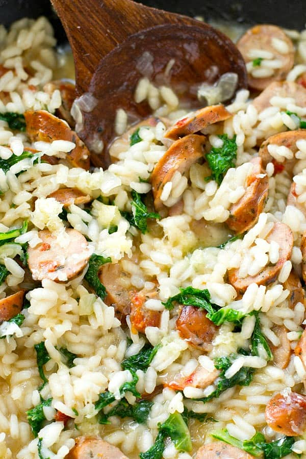 Creamy restaurant-style parmesan risotto loaded with plenty of sausage and kale, and made in one pot in only 30 minutes! Dinner is going to rock. @WholeHeavenly