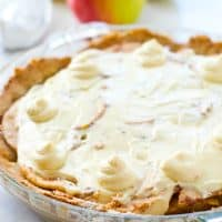 Homemade snickerdoodle cookie crust is filled with sweet apple pie filling and then topped with plenty of cream cheese frosting to create the ultimate snickerdoodle apple cheesecake pie!