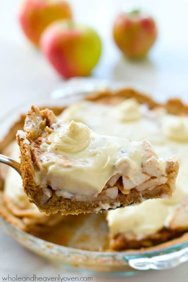 Homemade snickerdoodle cookie crust is filled with sweet apple pie filling and then topped with plenty of cream cheese frosting to create the ultimate snickerdoodle apple cheesecake pie! @WholeHeavenly