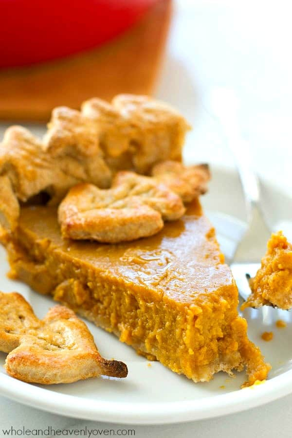 This silky classic Thanksgiving pumpkin pie recipe has been in my family for years and is the easiest and absolute BEST pumpkin pie you'll ever have. Everyone will want seconds! @WholeHeavenly
