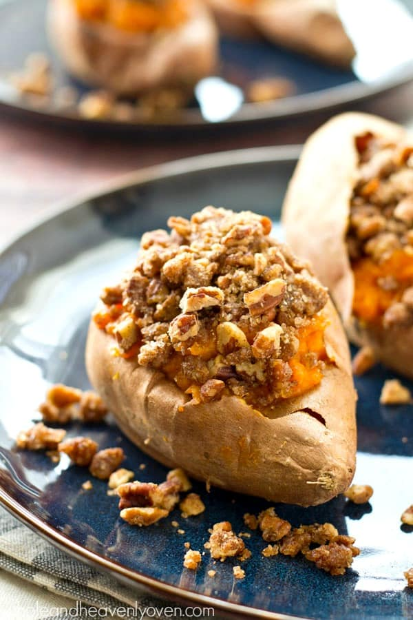 Piled high with buttery pecan streusel topping and baked twice to perfection, these twice-baked pecan streusel sweet potatoes will be the biggest hit of your Thanksgiving dinner!