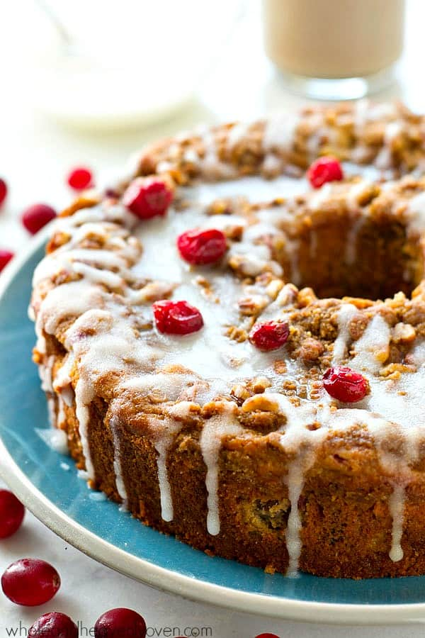 Swirled with a luscious cheesecake filling and topped with streusel and lots of glaze, this cranberry cheesecake swirl coffee cake is the ultimately impressive holiday breakfast! @WholeHeavenly