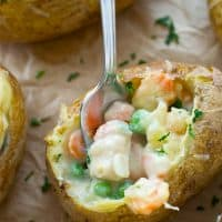 Get your chicken pot pie fix without all the work! These chicken pot pie potato skins are so easy to make and totally the ultimate comfort food appetizer!