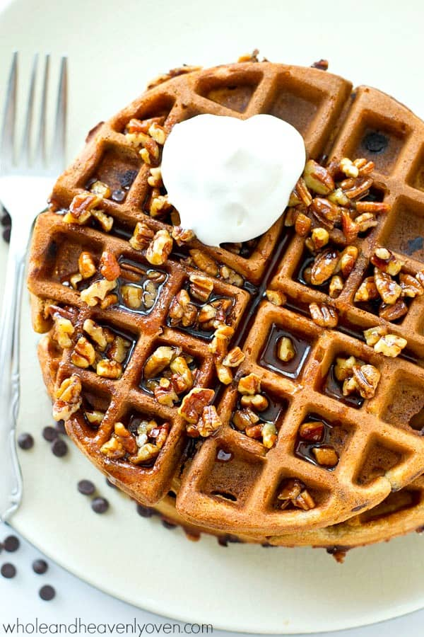 Crisp on the outside, fluffy on the inside, and covered with an unbelievable pecan maple syrup, these gingerbread chocolate chip waffles are going to become a weekend favorite!